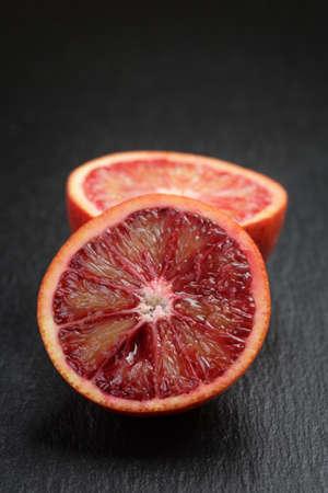 slate board: red sicilian oranges sliced on slate board