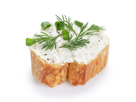 ricotta cheese: crunchy baguette slice with cream cheese and herbs isolated Stock Photo