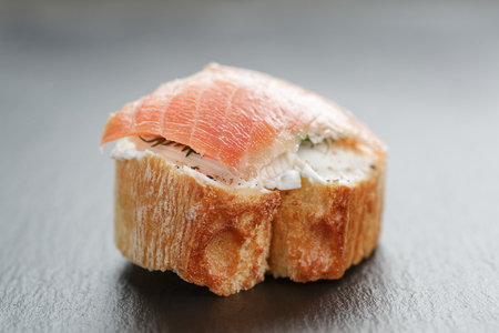small sandwich with soft cheese and salmon photo