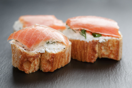 small sandwiches with soft cheese and salmon photo