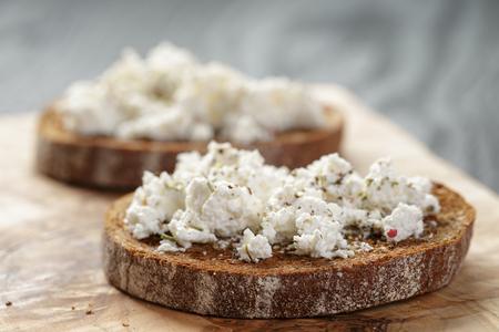 ricotta cheese: rye sandwich or bruschetta with ricotta cheese and herbs Stock Photo