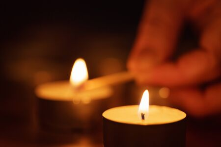 burns night: woman hand setting candle with beautiful out of focus, shallow DOF
