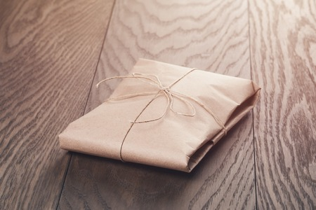stack of papers: vintage style parcel wrapped with rope, toned photo Stock Photo