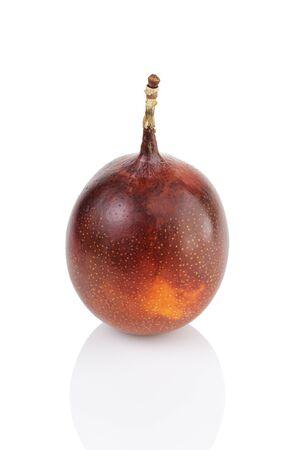 grenadilla: one ripe whole passionfruit, isolated on white background