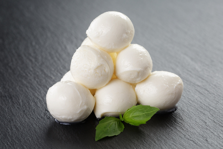 pyramid shape: mozzarella balls on slate board, pyramid shape