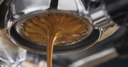 bottomless: espresso coffee extraction with bottomless filter, close up