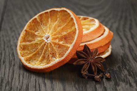dried orange: dried orange slices with anise star, on old wood table