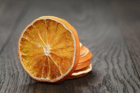 dried orange: dried orange slices, on old wood table Stock Photo