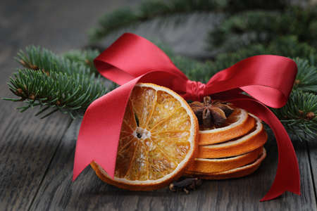 fir twig: orange and anise with fir twig and ribbon bow, photo with shallow dof