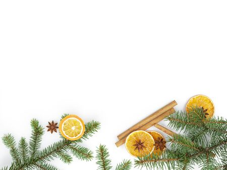 fir twig: fir twig with dried orange slice on white background, christmas backdrop Stock Photo