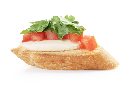 pic nic: crostini with tomato, mozzarell and parsley isolated on white