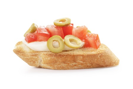 pic nic: crostini with tomato, mozzarell and olives isolated on white