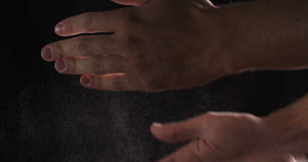 clasping: man hands clasping with flour, motion blur
