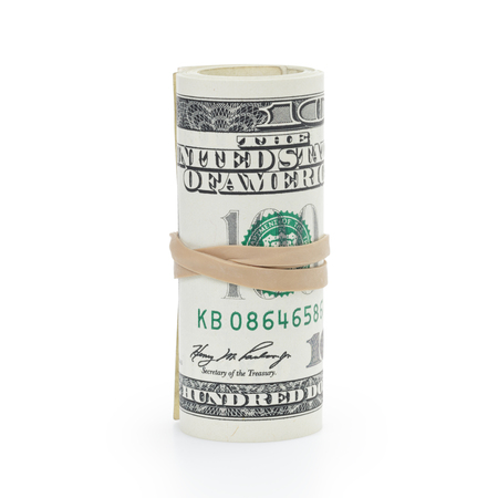 elastic band: roll of 100 dollar banknotes tied with elastic band isolated on white background. Stock Photo