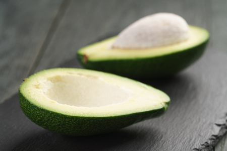 shallow  focus: ripe avocados on slate board, shallow focus Stock Photo