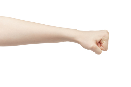 young female left hand shows fist, isolated on white background