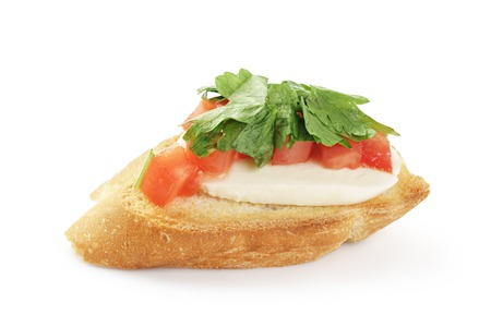 bap: crostini with tomato, mozzarell and parsley isolated on white