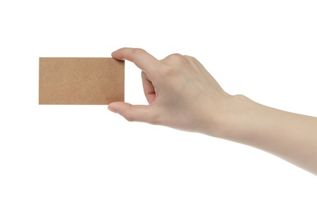 cash slips: young female right hand hold blank brown paper card, isolated on white Stock Photo