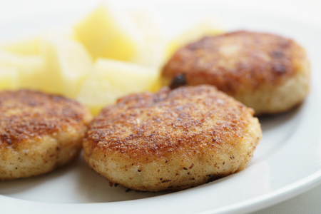 fresh food fish cake: prepared fried fish cakes with boiled potatoes, shallow focus