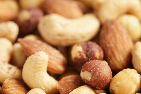 shallow  focus: salted nut mix background, closeup shallow focus Stock Photo