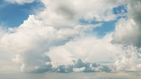 puffy: blue sky with dramatic clouds, puffy fluffy clouds