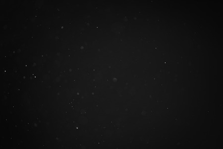 fx: dust particles overblack background fx backdrop, real photo no cgi