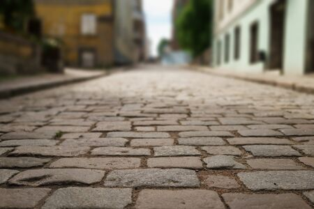 empedrado: perspective view of old paved road in town, background