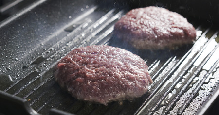 beefsteaks: beefsteaks for burger on grill pan, preparing meat for burgers