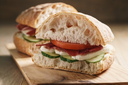 italian sandwich with speck and mozzarella, simple homemade food Stock Photo