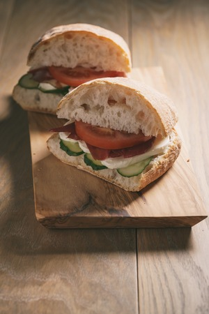speck: italian sandwich with speck and mozzarella, simple homemade food Stock Photo