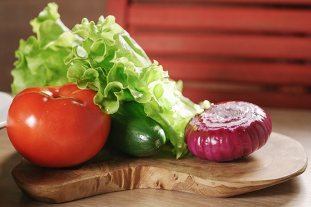 raw vegetables on kitchen table, ingredients for burger Stock Photo