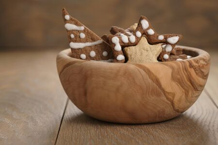 chrismas chocolate cookies in wooden bowl on oak table with copy space, holliday dessert Stock Photo