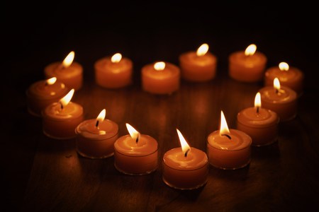 tealight candles in a shape of a heart, shallow focus photo