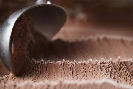 scooping chocolate ice cream close up shot, shallow focus Stock Photo