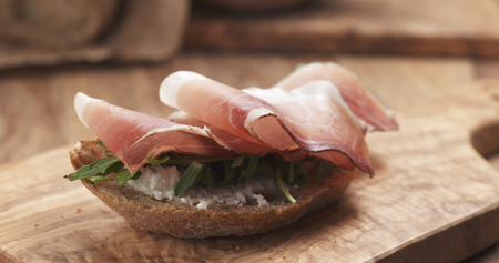 sandwich with italian speck, arugula and cream cheese, 4k photo Stock Photo