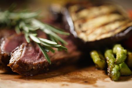 angus: sliced medium rib eye steak with grilled vegetables