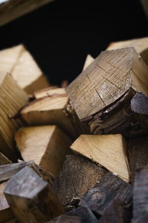 natural firewood stack rustic background closeup, chopped wood