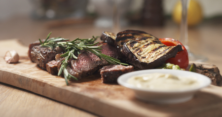 corrects: rib eye steak with grilled vegetables