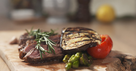 piece of rib eye steak with vegetables