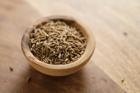 cumin zira seeds in wood bowl on table