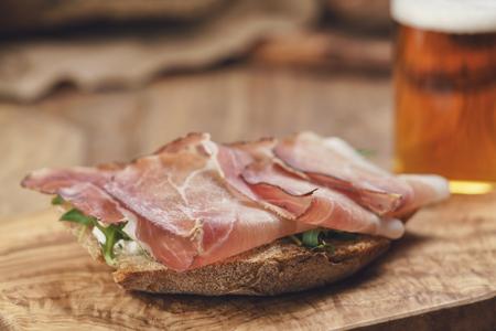 hams: italian sandwich with speck, arugula salad and beer