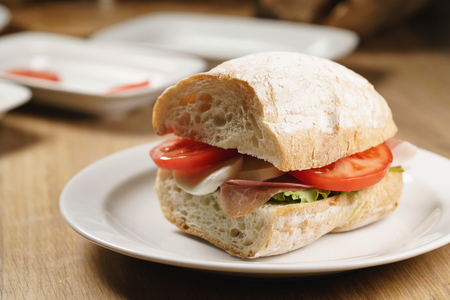 ciabatta sandwich with speck, mozzarella and vegetables