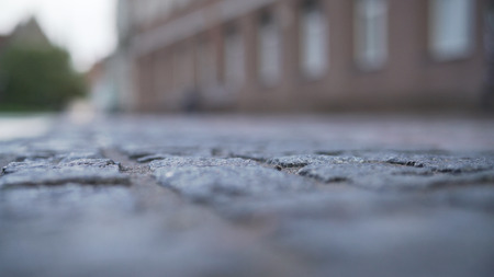 low angle closeup background of old pavement in tallinn with blurred background Stock Photo