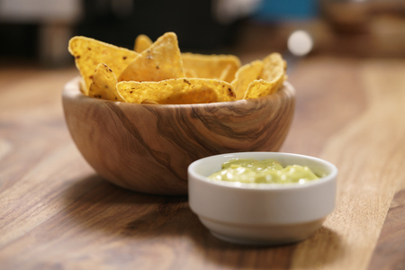 nachos with guacamole sauce on table Stock Photo