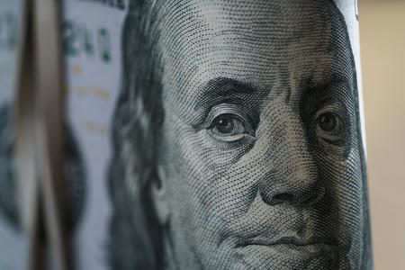closeup portrait of Benjamin Franklin on hundred dollar bill 写真素材
