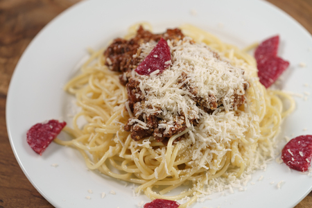 spaghetti bolognese with fuet sausage Stock Photo