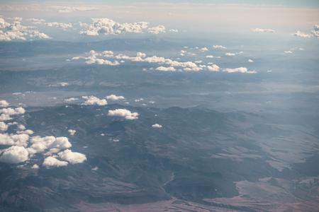 aerial shot from plane flying above the desert in daytime