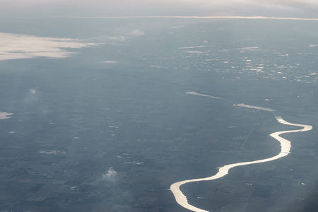 view of fields and rivers from airplane flying over USA