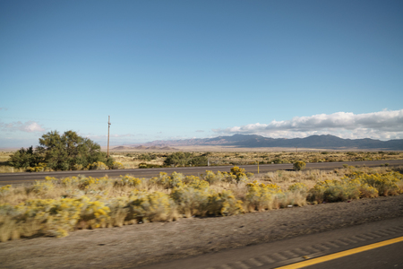 Driving plate side view moving through desert in car with motion blur