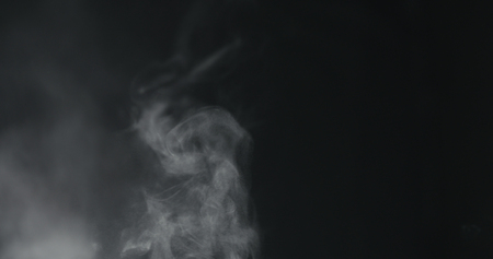 vapor steam rising over black background